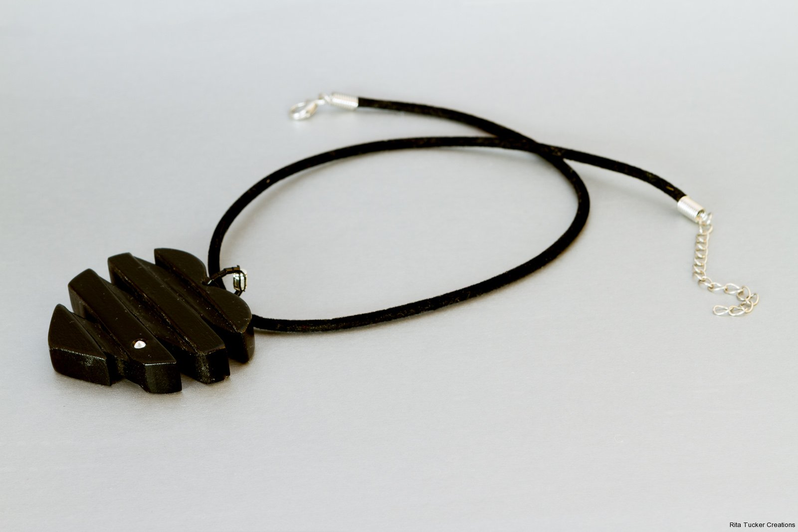 carved ebony wood pendant