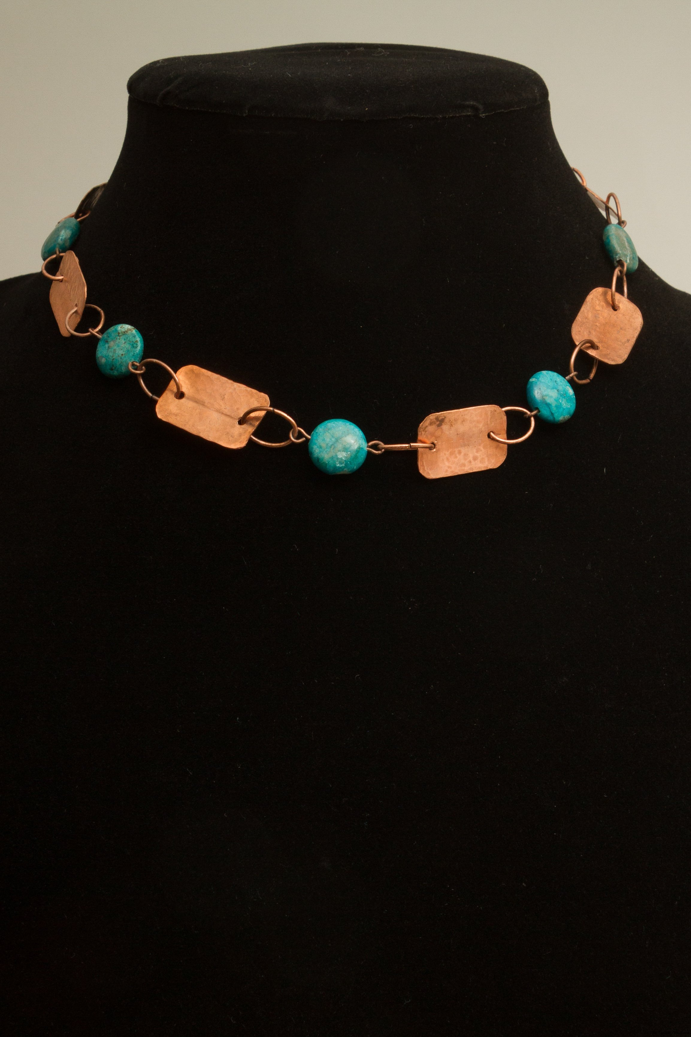 copper rectangles connected by turquoise beads