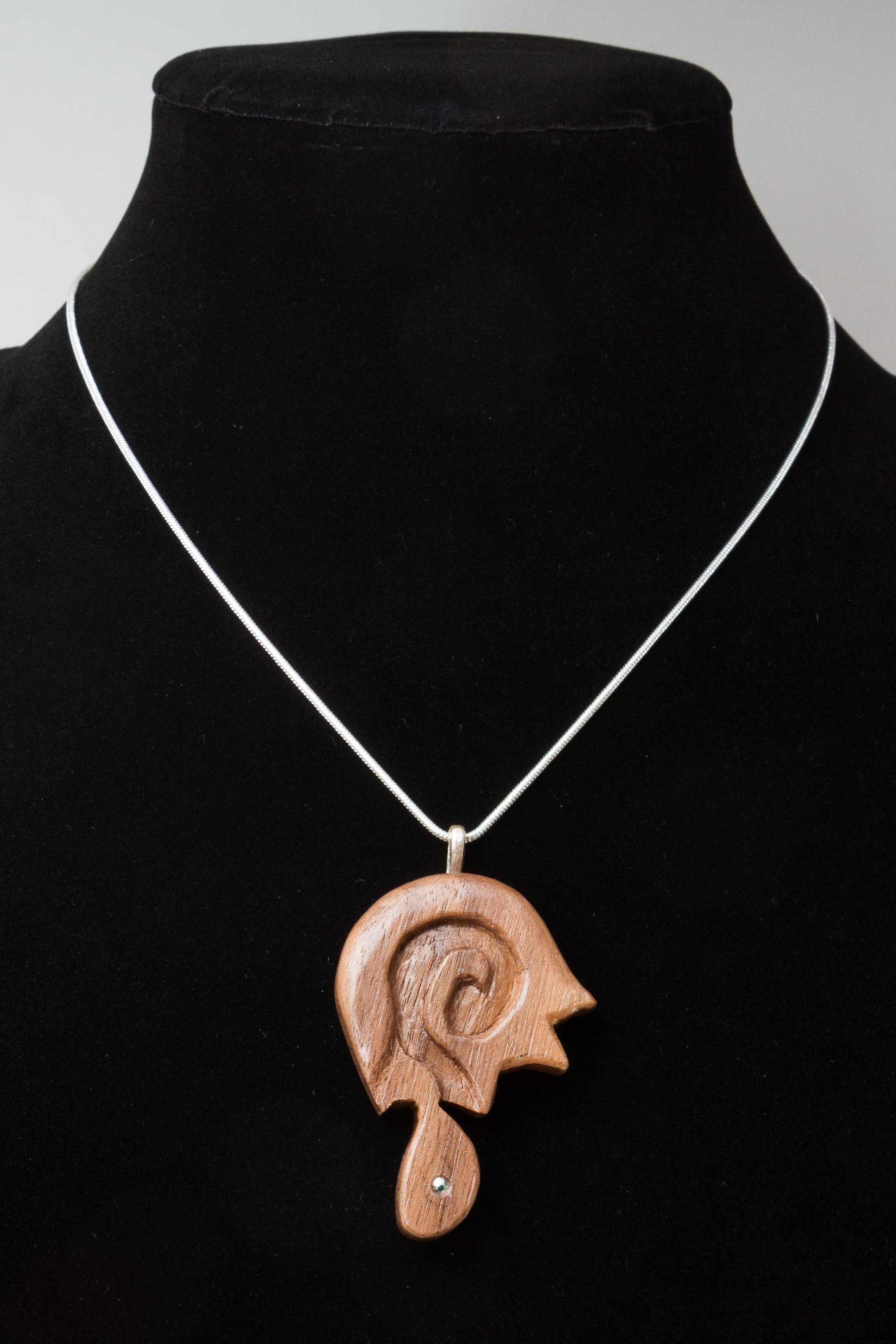 carved walnut pendant