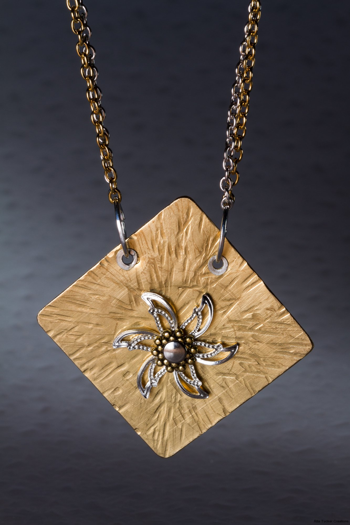 silver and brass necklace with riveted star design