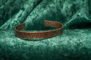 narrow copper bracelet etched with stars