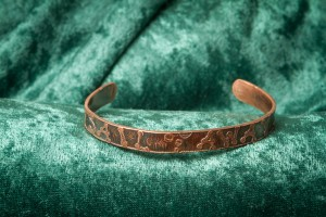 "narrow copper bracelet inscribed ""Sail Away"""