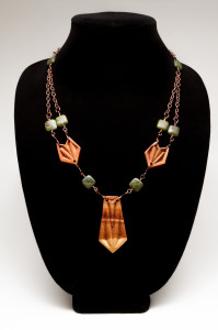 Necklace of chip carved juniper on a copper chain
